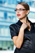Close up Pretty Young Office Woman in Eye Glasses and Black Outfit  Looking at the Right Frame. Capt