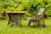 foto of neglect  - Very old and unused cast iron furniture in garden - JPG