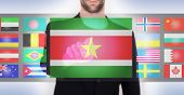 stock photo of suriname  - Hand pushing on a touch screen interface choosing language or country Suriname - JPG