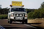 Pilot Car Before A Huge Australian Truck