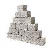 Pyramid made of small granite rock blocks.