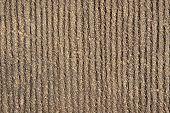 Brown striped concrete.