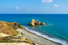 foto of saracen  - The cozy beach next to the Aphrodite birthplace with the Saracen rock in the sea Paphos Cyprus - JPG