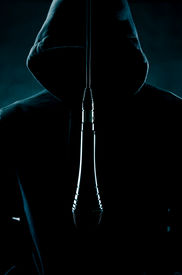 pic of gangsta  - image of someone wearing a hood standing in front of a microphone - JPG