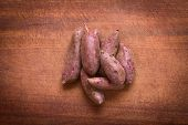 pic of batata  - Overhead shot of raw purple sweet potato  - JPG