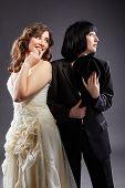 Elegant lesbian couple posing as bride and groom