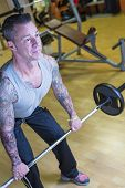 image of bent over  - man making bent over barbell row  - JPG