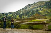 Unidentified tourists visiting Ingapirca important inca ruins in Ecuador