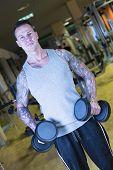Man Making Lateral Raises - Workout Routine .
