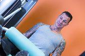 Man Making Leg Curls - Workout Routine .