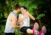 foto of seesaw  - Young sport couple having fun  - JPG