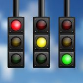 Realistic traffic lights on sky background