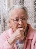 stock photo of saddening  - Portrait of old sad woman at home - JPG