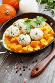 stock photo of saucepan  - Baked pumpkin and chicken meatballs with herbs in a saucepan - JPG