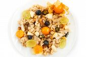 oat muesli or oatmeal with grape, blueberry and physalis on white