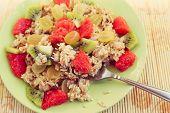 oat muesli on fork, healthy breakfast
