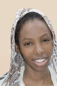 Young Afro beauty wearing a veil in the street