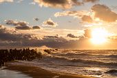 pic of windy weather  - Beautiful seascape with waterbreak and splashes at sunset while windy and stormy weather on Baltic sea coast in Liepaja - JPG