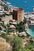 Beautiful view of the city Alanya in Turkey. Red tower and harbor