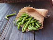 green beans in a linen bag on wooden