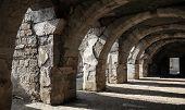 Dark Corridor Interior With Arcs. Ruins Of Ancient Smyrna