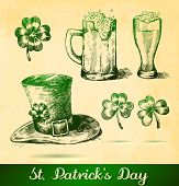 Two Beers With Clovers For St Patrick's Day. St. Patrick's Hat With Four-leaf Clover And Paper Backg