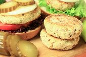 picture of patty-cake  - Vegan sea burger and patties closeup on wooden surface - JPG