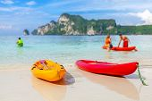 Kayaks On A Tropical Beach, Shallow Depth Of Field.