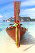 Old Traditional Wooden Boat On A Tropical Beach.