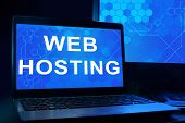 Computer with words Web Hosting.