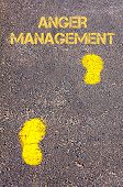foto of anger  - Yellow footsteps on sidewalk towards Anger Management message - JPG
