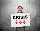 picture of crisis  - crazy businessman holding poster with crisis concept - JPG