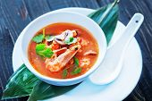 stock photo of gai  - fresh asian soup in bowl and on a table - JPG