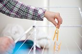 foto of laundry  - woman hanging laundry to laundry stand - JPG