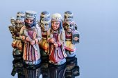 picture of figurines  - chess figurines placed on a blue background - JPG