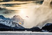 image of kites  - Two kite surfing on a frozen lake in the high mountains - JPG