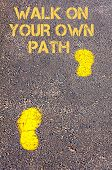 Yellow Footsteps On Sidewalk Towards Walk On Your Own Path Message