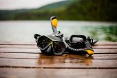 foto of rubber mask  - Snorkeling Mask and Tuba on Dock After a Dive - JPG