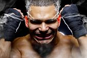 foto of outrageous  - portrait of a fighter who is smoking or steaming from intensity - JPG