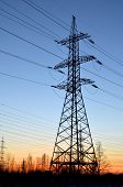 picture of transmission lines  - Electric transmission line tower against blue sky - JPG