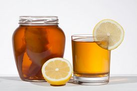 stock photo of pro-life  - Kombucha superfood pro biotic beverage in glass with lemon on white background - JPG