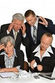 image of work crew  - Portrait  of business people at work with laptop - JPG