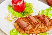 foto of veal meat  - roast of veal meat with bacon with potatoes - JPG