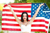 pic of independent woman  - Sexy woman holding USA flag outdoor independence day 4th of july - JPG