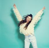 image of crazy face  - studio portrait of cheerful fashion hipster girl going crazy making funny face and dancing - JPG