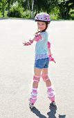 pic of roller-skating  - Cute smiling little girl in pink roller skates and protective gear outdoor  - JPG