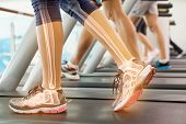 pic of ankle shoes  - Digital composite of Highlighted ankle of woman on treadmill - JPG