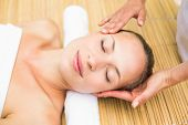 stock photo of day care center  - Close up of an attractive young woman receiving facial massage at spa center - JPG