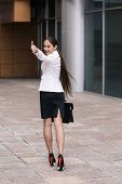 image of girl walking away  - Beautiful businesswoman walk away and show thumb up - JPG