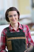 picture of carpentry  - Portrait of young woman in carpentry school  - JPG